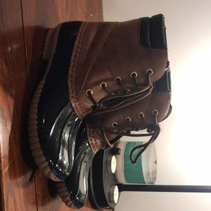 Tan and black duck boots
